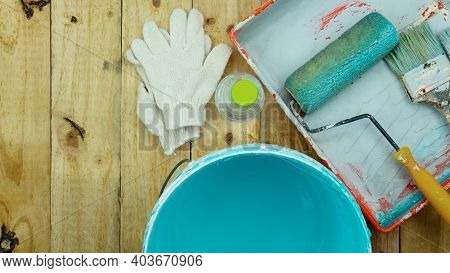 Set Of Tools For Painting Wall On Wood Background At Home.