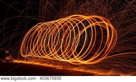 Swing Fire Swirl Steel Wool Light Photography With Reflex In The Water Long Exposure Speed Motion St