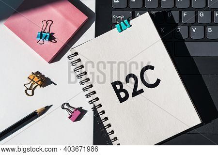 Notebook With Tools And Notes About B2c Business To Consumer Lies On Laptop.