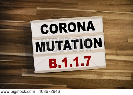 Lightbox Or Light Box And With Message Corona Mutation B117 On Wooden Background Table