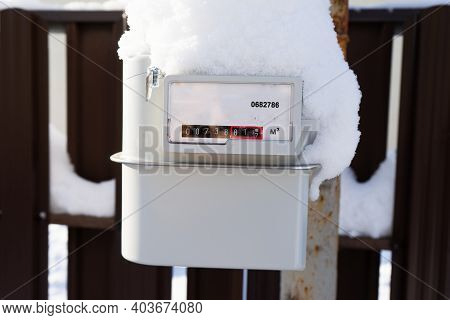 The Gas Meter Is Covered With Snow And Frost. Frozen Outdoor Gas Meter.