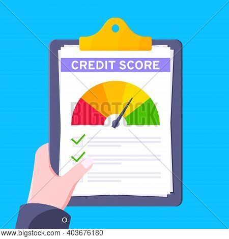 Hand Holds Credit Score Gauge Speedometer Indicator With Color Levels On Clipboard. Measurement From