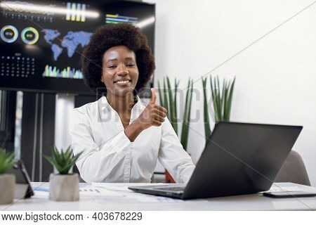 Close Up Portrait Of Young Smiling Successful African American Business Woman, Posing To Camera With