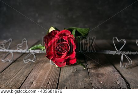 Love Symbol Red Roses With Hearts On Dark Wooden Vintage Planks. Valentines Day Background With Spac