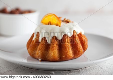 Traditional Italian Rum Cake With Almonds. Delicious Sweet Rum Baba Cake With Sugar Glaze On A White