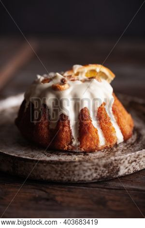Traditional Italian Rum Cake With Almonds. Delicious Sweet Rum Baba Cake With Sugar Glaze On A Woode