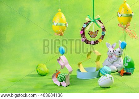 Easter Eggs, Cookie Cutters And Funny Bunnies. Easter Concepts With Copy Space.