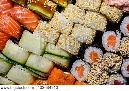 Set Of Sushi And Rolls Close-up Background, Delivery From A Restaurant. Salmon, Unagi, California An