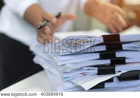 Employee Woman Hands Checking Business Unfinished Documents  With Stacks Paper Files And Searching D