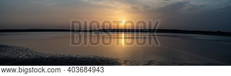 Sunset Panorama On A Calm River. Broad River At Golden Hour.