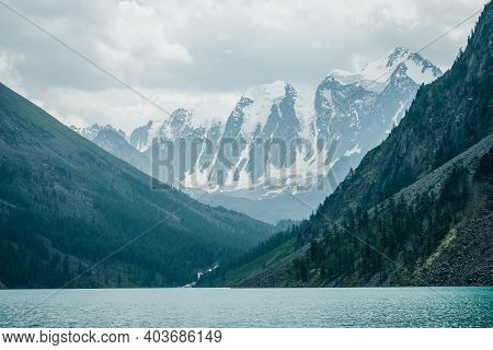 Amazing View To Big Snowy Mountains And Mountain Lake With Azure Clear Water. Atmospheric Scenery Wi