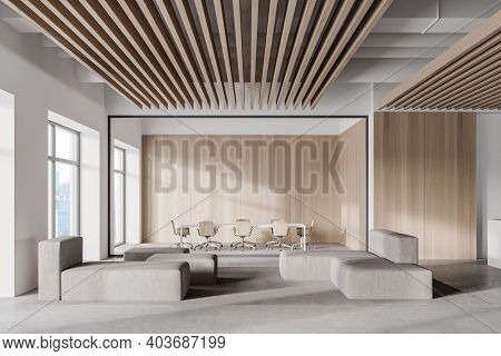 Interior Of Modern Office Waiting Room With White And Wooden Walls, Concrete Floor, Gray Sofas And R