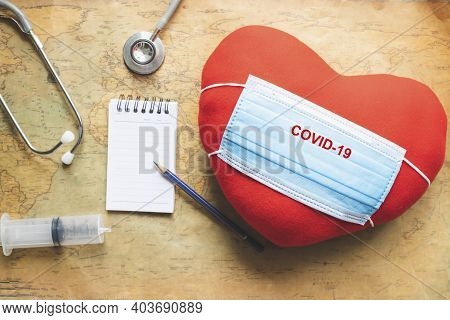 Heart With Note Notepad Medical Stethoscope On Map Covid 19 For Stop Covid 19 Virus Covid-19 Or Coro