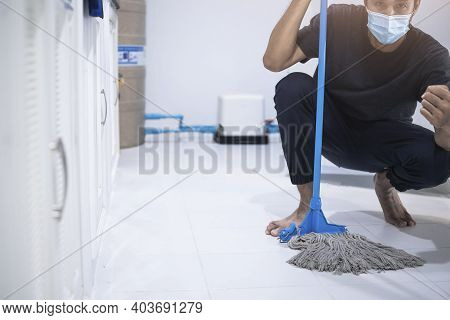 Asian Man Inspection Cleaning Staff In Kitchen, Bathroom Blurry Background Metaphor For Cleaning Get