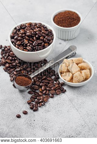 Fresh Raw Organic Coffee Beans In White Bowl And Powder On Ligh Table Background With Cane Sugar And