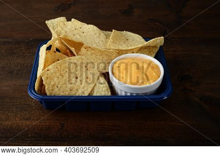 Closeup Nacho Chips With Cheese In Plastic Container