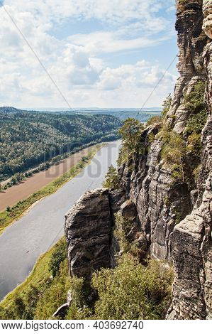 View Of The River Valley Of The Elbe With The Typical Eroded Sandstone Formations On The Edge Of Sax