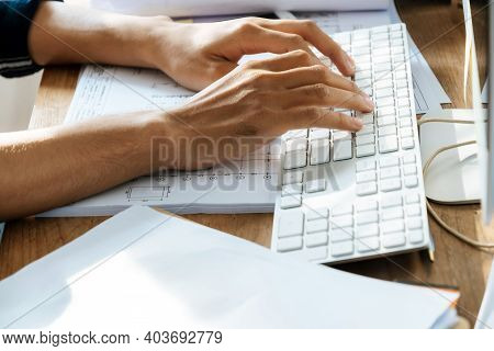 Businessman Or Construction Worker Hand Working About Finance Business On Keyboard Computer At Home