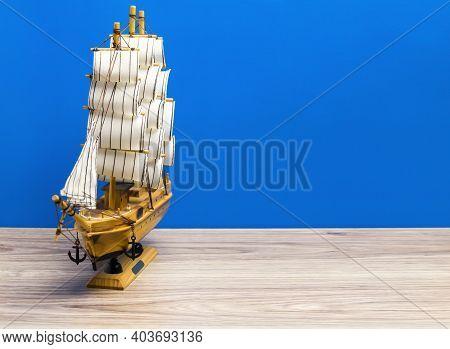 Souvenir Boat On A Blue Background. Marine Background.
