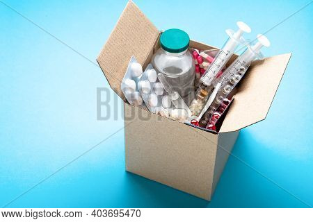 Delivery Of Medicines Home From The Pharmacy. Cardboard Box With Medicines, Pills, Bottles, Injectio