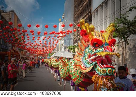 Bangkok, Thailand - Jan 25 2020: Group Of People Perform A Traditional Dragon Dance Parade At Chinat