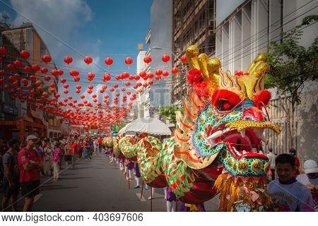 Bangkok, Thailand - Jan 25 2020: Group Of People Perform A Traditional Dragon Dance Parade At Chinat