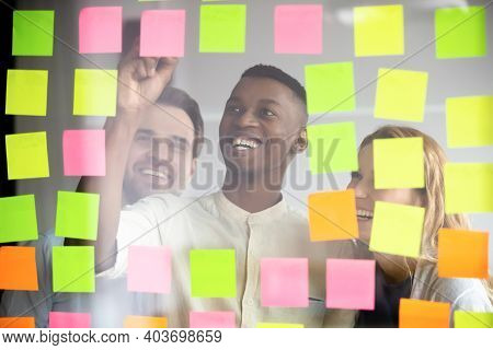 Happy Young African American Male Employee Organizing Working Processes.