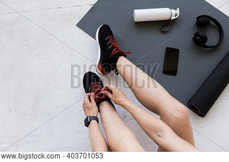 Devices For Workout Or Jogging, Healthy Lifestyle At Covid-19 Quarantine. Adult Lady With Fitness Tr