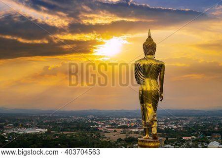 Behind Buddha Statue Before Sunset Time At Wat Phra That Kao Noi Nan, Thailand.
