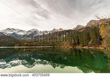 Lake Tovel (lago Di Tovel) And The Brenta Dolomites (dolomiti Di Brenta) In Italian Alps, National P