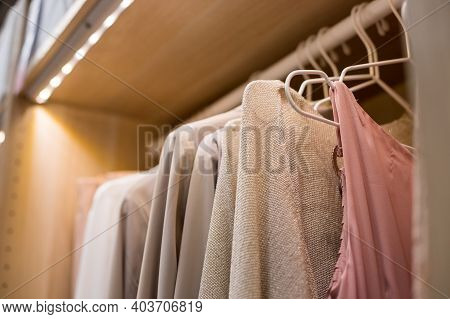 Many Blouses, Shirts On Hangers In The Dressing Room.modern Wardrobe With Stylish Spring Clothes And
