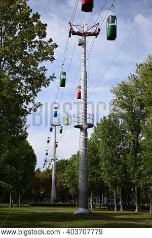 Brightly Colored Cable Cars Carry Tourists. Running On Wires Supported By Steel Pylons, It Is The Lo