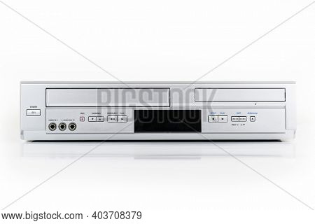 Old video tape and dvd player machine on white.