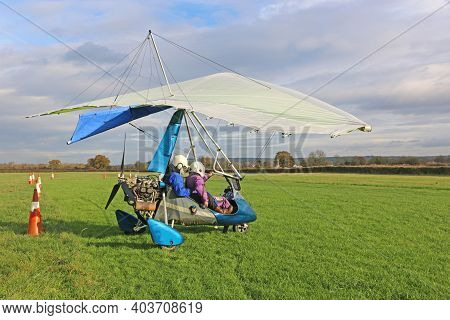 Ultralight Airplane In A Landing Field	 Preparing To Fly