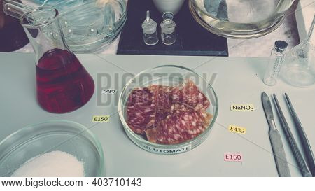 Photo Food Additives In Sausages. Additives Are On The Table Next To The Sliced Sausage In The Lab.