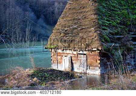 Small house in chemical residuals flooded natural environment, ecological bomb. Geamana, Rosia Montana, Romania