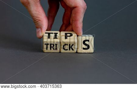 Tips And Tricks Symbol. Businessman Turns Cubes And Changes The Word 'tricks' To 'tips'. Beautiful G