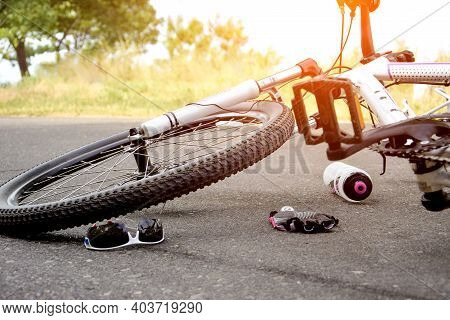 Accident With A Bicycle On The Road. Wheel Closeup.