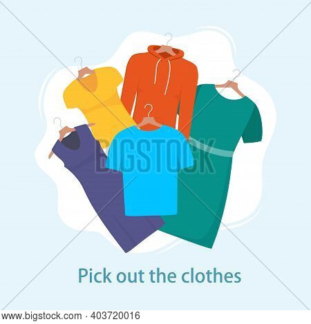 Men And Women Casual Clothes On Hangers. Different Casual Things: Dress, T Shirt, Sweatshirt. Choosi