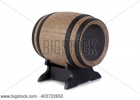 Small wooden barrel for whiskey and shot. Isolated object on white background
