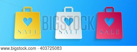 Paper Cut Shoping Bag With An Inscription Sale Icon Isolated On Blue Background. Handbag Sign. Woman