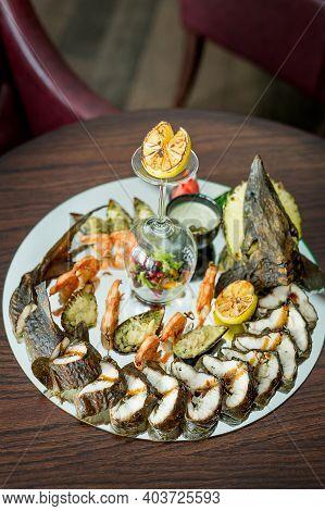 Platter Of Vegetables And Seafood. Assorted Seafood: Fried Calamari, Grilled Shrimp With Sauce. Bake