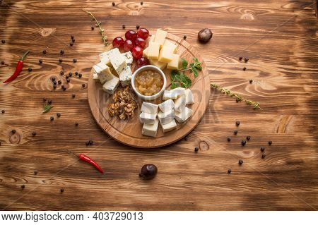 Appetizer Of Assorted Cheeses For Wine. Cheese Platter Assorted: Dor Blue, Cheddar, Goat Cheese, Fet
