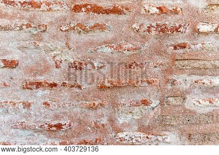 Close Up Of Stonewall With Red Brick Texture