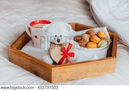 Valentines Day Breakfast In Bed For Lover. Teddy Bear With A Heart-shaped Gift Box With Red Ribbon,