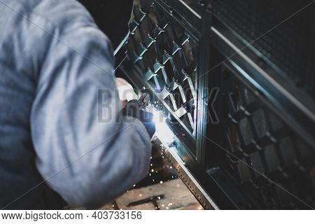 Welder Welds The Steel Gear Racks To Gate Before Setting Up Automated Gate Operator. Professional Se