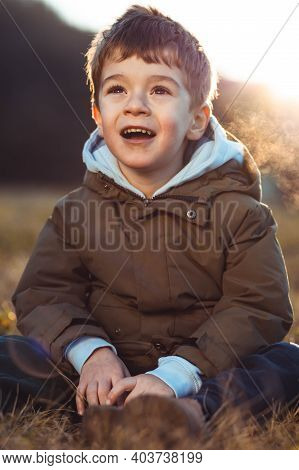 Portrait Of A Cute, Little Boy Looking At Something In Awe, With Open Mouth
