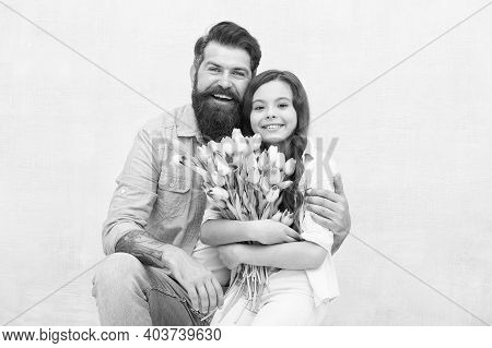 Happy Childrens Day. Happy Family Celebrate Childrens Day. Father Embrace Little Daughter Holding Fl