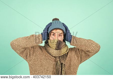 It Is Cold Outside. Man Handsome Unshaven Guy Wear Winter Accessories On Blue Background. Shopping C