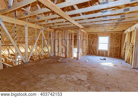 Frame House Roof Of Pipe Heating System, House Attic Under Construction Unfinished Frame Wooden Beam